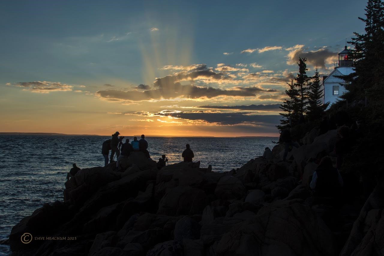 Photographers at Sunset with Bass Harbor Lighthouse, Maine. A copyright Image for https://photographyworld.org/carousel-gallery/