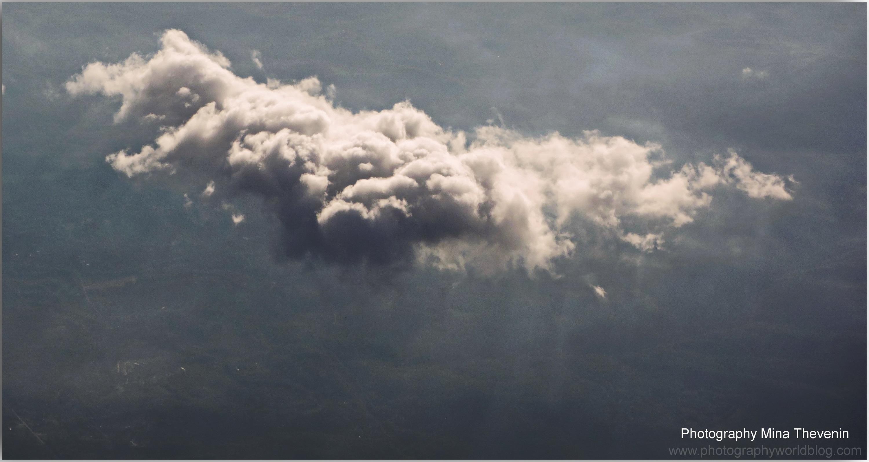 © Single Cumulus Cloud. Photograph by Mina Thevenin. Photography World Online Publication. www.photographyworld.org