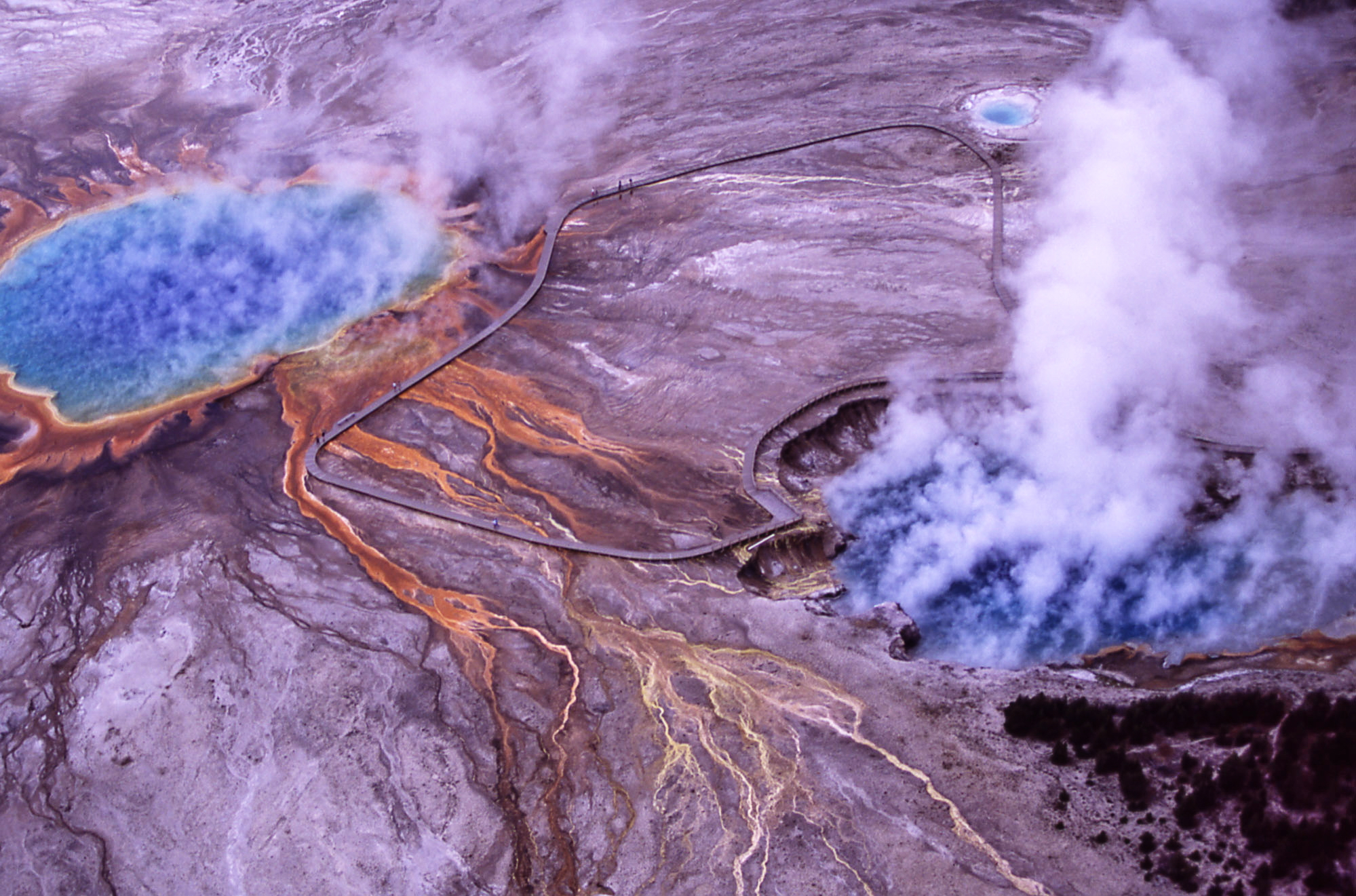 Aerial of Excelsior Geyser Crater & Grand Prismatic Spring. Photograph by Jim Peaco. July 2001. PHOTOGRAPHY WORLD article, YELLOWSTONE Photography- 75 Years @ photographyworld.org