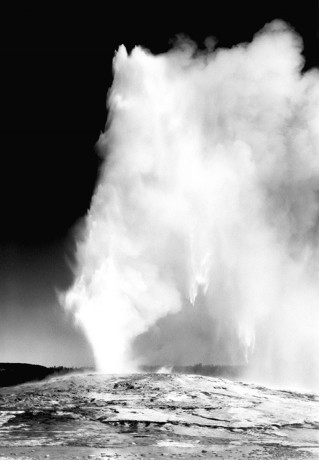"79-AAT-25 Old Faithful Geyser, Yellowstone National Park,"" taken at dusk dawn from various angles during eruption. [Electronic Record]. Photograph by Ansel Adams. Courtesy of the U.S. National Archives. PHOTOGRAPHY WORLD Article: YELLOWSTONE Photography- 75 Years"
