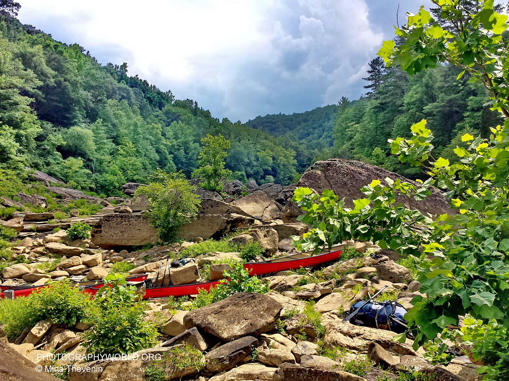 Red Canoes at Portage. BIG SOUTH FORK. Photograph by Mina Thevenin for photographyworld.org @ https://photographyworld.org/nature/whitewater-canoeing/
