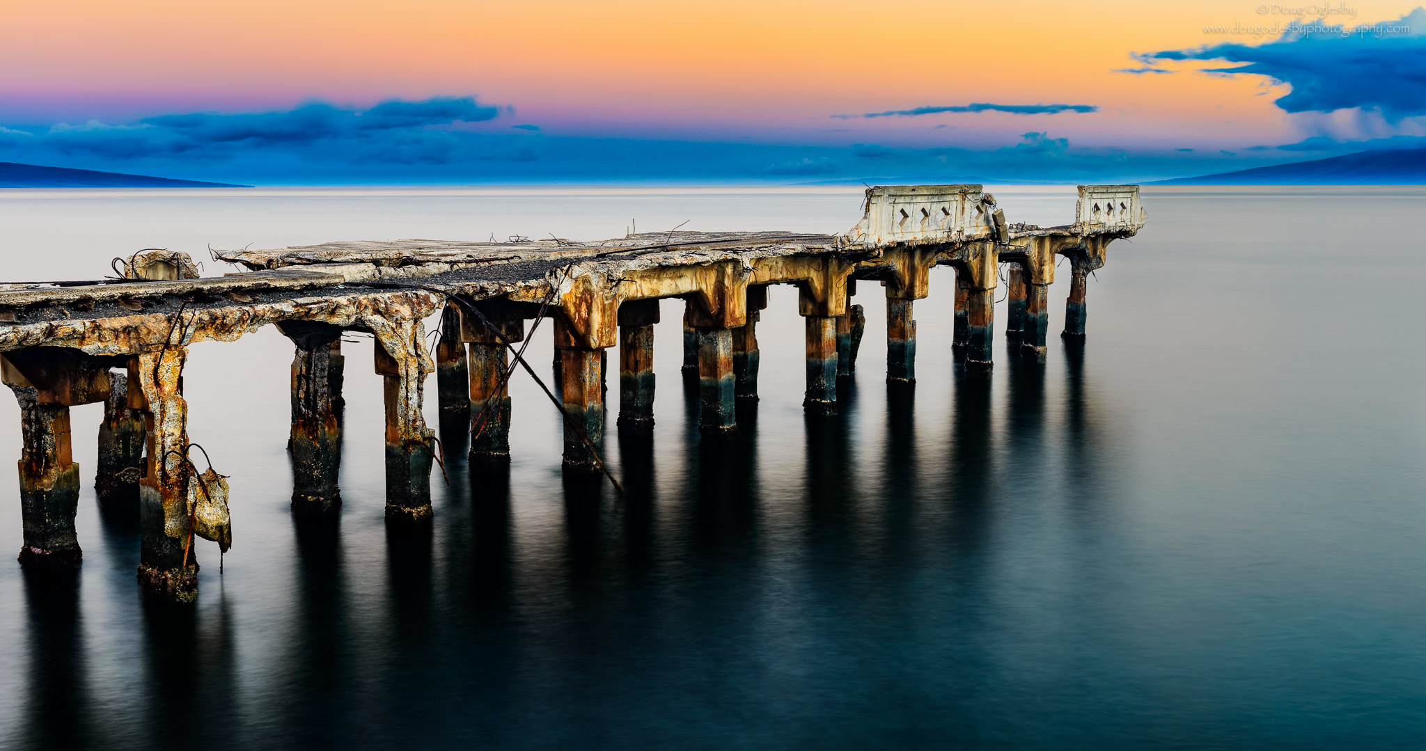 A pier destroyed by Hurricane Iniki in Lahaina, Mau'i. Copyright image by Photographer Doug Oglesby @ https://photographyworld.org/nature/early-hawaii-history/
