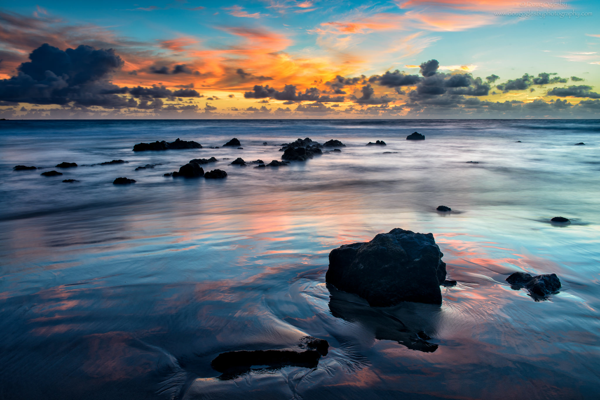 Sky reflecting in the sands of Koki Beach in Hana, Mau'i. Copyright image by Photographer Doug Oglesby @ https://photographyworld.org/nature/early-hawaii-history/